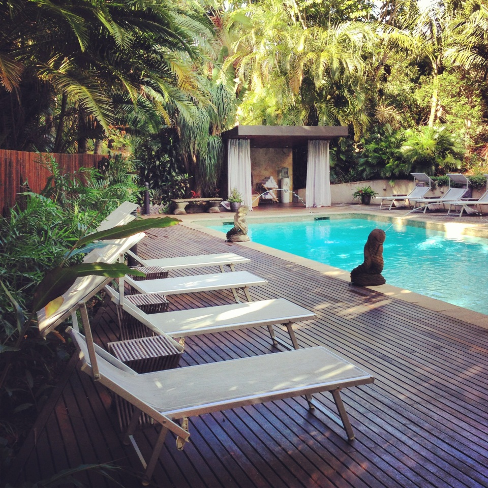 RELAX ON A DAY BED BY THE SPARKLING POOL | GAIA DAY SPA
