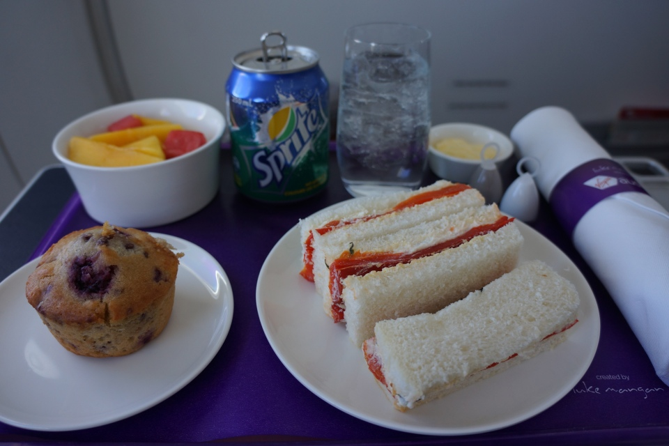 RED CAPSICUM, FETA & PINE NUT SANDWICH FINGERS, FRUIT SALAD AND BLUEBERRY MUFFIN | BUSINESS CLASS MENU